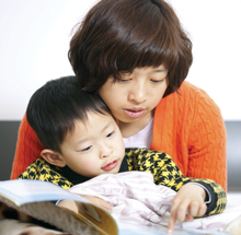 Parent and child looking at a reading book