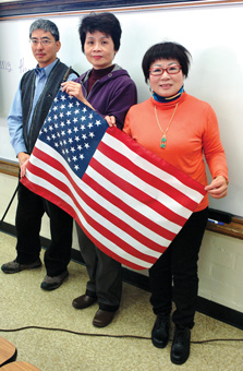 ESL students holding a US flag